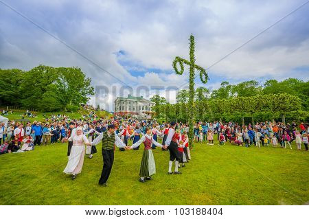 Dancing Around The Maypole In Midsummer, Gothemburg, Sweden
