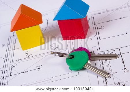 Houses Of Wooden Blocks And Keys On Construction Drawing Of House, Building House Concept