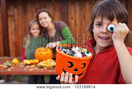 Family preparing for the halloween - carving pumpkin jack-o lanterns