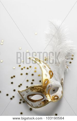 Carnival mask on light grey background. Background for party invitation card. Space for text.