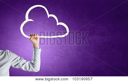 Hand of businessman on color background catching drawn cloud