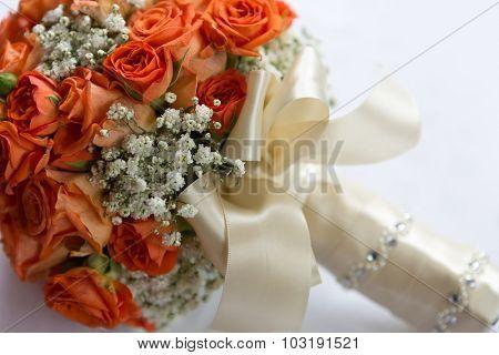 Wedding bouquet made of orange roses on white