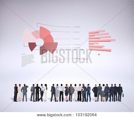 Rear view of multiethnic business people standing side by side against grey background