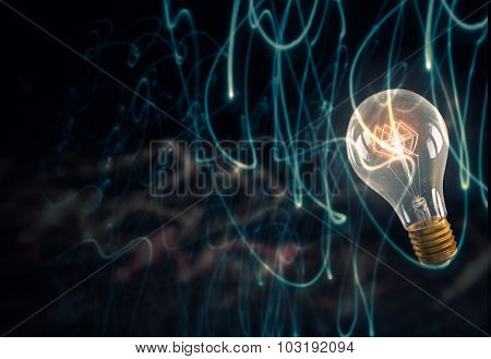 Glowing glass light bulb on dark background