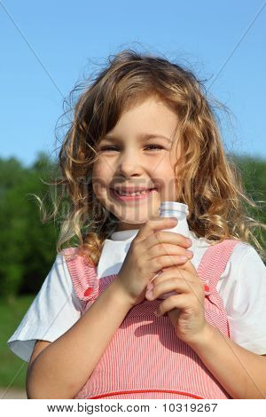 Beautiful Little Girl With Yoghurt Small Bottle