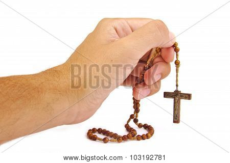 Man prays with a rosary in hands isolated on white background