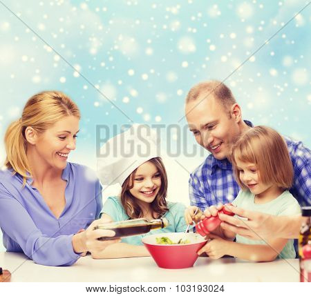 food, family, children, hapiness and people concept - happy family with two kids making salad for dinner over blue sky and snowflakes background