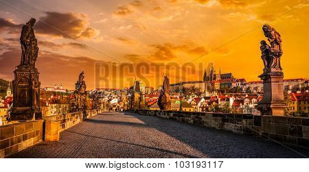 Panorama of Charles bridge with statues and Prague castle on surise. Prague, Czech Republic