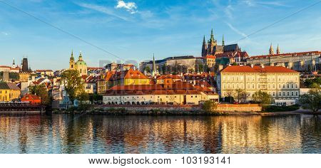 Panorama of Gradchany (Prague Castle) and St. Vitus Cathedral over Vltava river on sunset