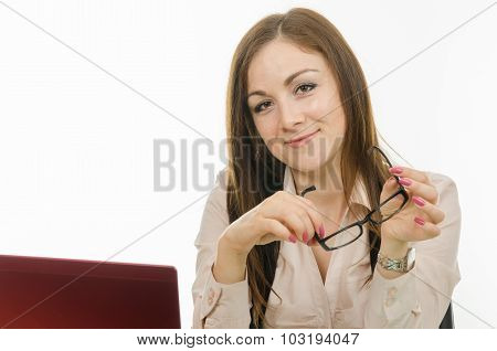 The Girl At The Computer With The Glasses In His Hand