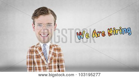 Geeky businessman against grey wall