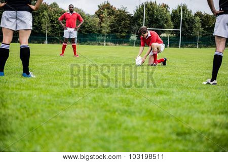Rugby players playing a match at the park