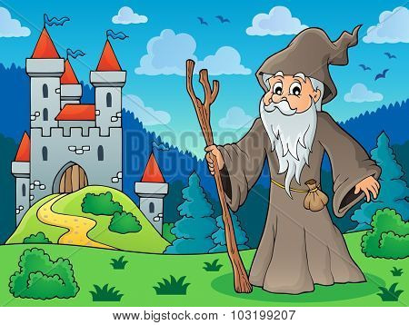 Druid on meadow near castle - eps10 vector illustration.