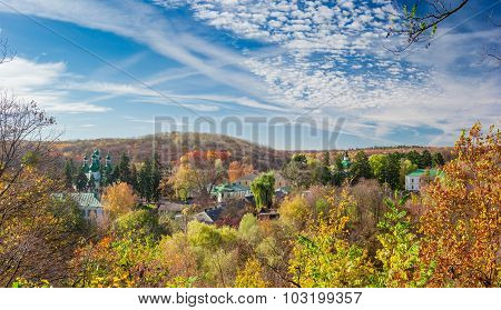 Orthodox Monastery In The Forest Against The Sky With Clouds