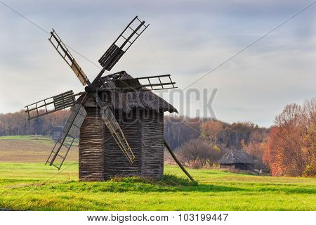 Old Windmill On A Background Of Forest And Sky