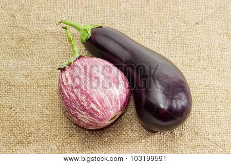 Conventional Eggplant And Graffiti Eggplant On A Sackcloth