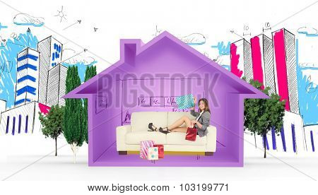 Woman lying on couch with shopping bags against house shape with kitchen sketch