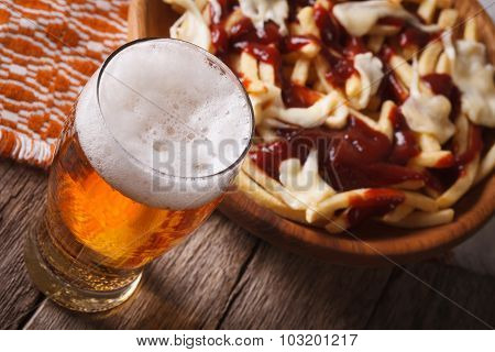 Quebec Food: Beer And Potatoes With Sauce Close-up. Horizontal