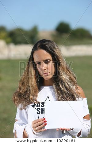 Woman Holding A White Card