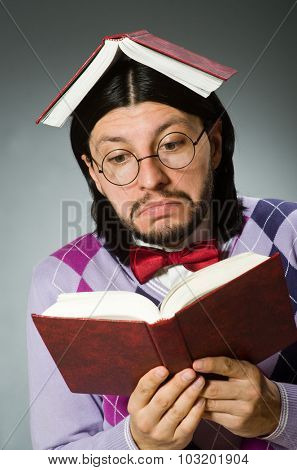 Young student with book in learning concept