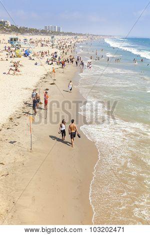 People Resting On Beach During Peak Season.