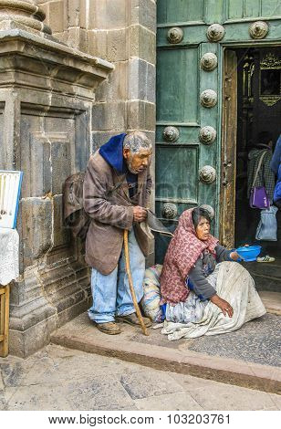 Homeless Indian Woman Begs For Money In Front Of The Church  In Cuzco