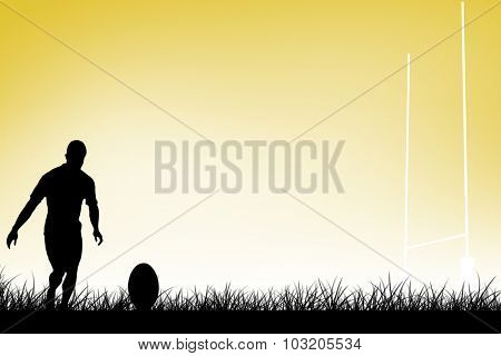Rugby player doing a drop kick against yellow vignette