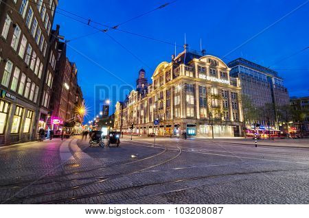Amsterdam, Netherlands - May 7, 2015: Tourist Visit De Bijenkorf Store On Dam Square