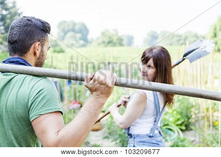 young couple go to work in your garden