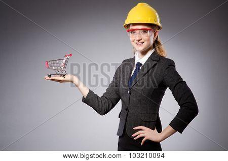 Construction worker in helmet against gray