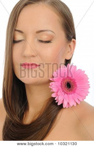 Beautiful Woman With Pure Healthy Skin And Long Hair And Pink Flowers Relaxing. Isolated On White Ba