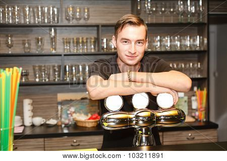 The Young Man Behind The Bar.