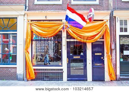 AMSTERDAM - APR 27: Decorated dutch cafe in Amsterdam at Kings Day on April 27. 2015 in the Netherlands