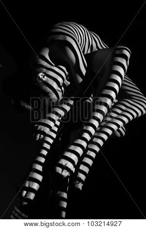 The nude woman with black and white zebra stripes