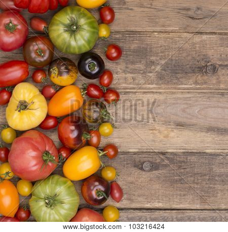 Collection of various tomatoes, top view, with copy space