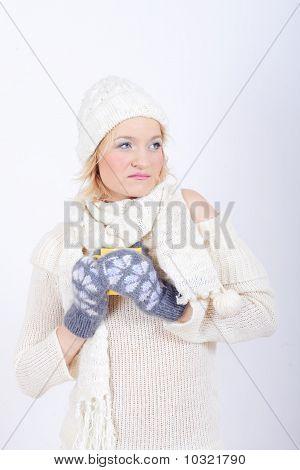 Pretty winter woman in warm clothes
