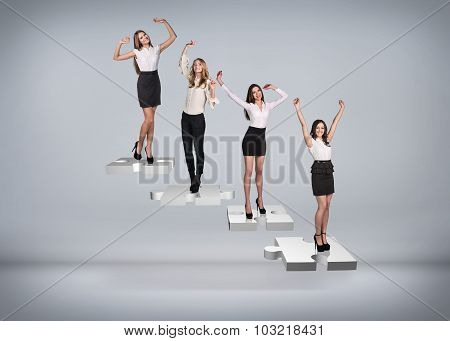 Business people stand on puzzle stairs