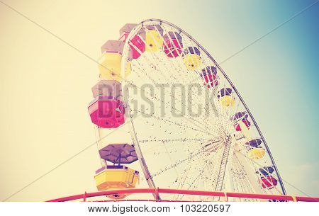 Old Film Retro Style Picture Of An Amusement Park.