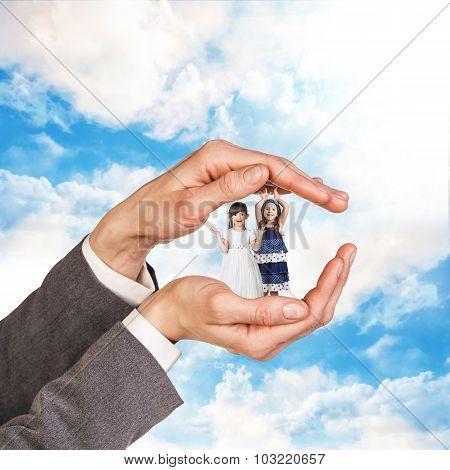 Children in big hands