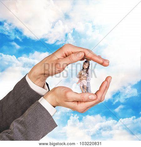 Child in big mans hands