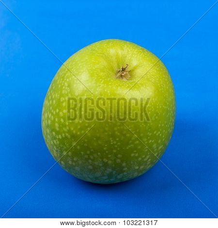 Green apple with leaf.