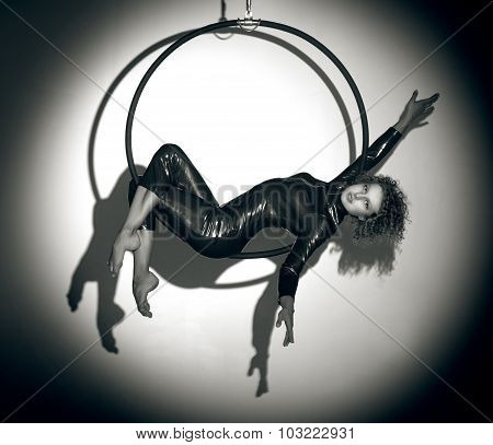 Sporty girl posing with aerial hoop