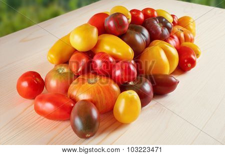 Tomatoes On A Wooden Table. Selection Grade.
