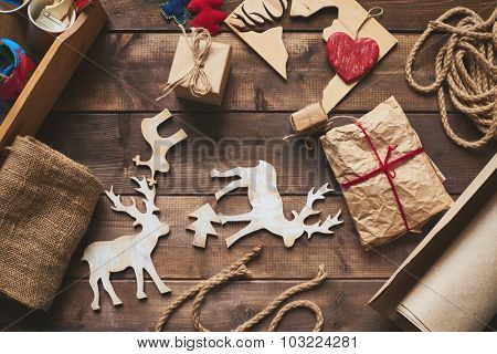 Wooden xmas symbols and packed gifts