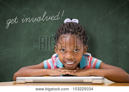 The word get involved! and smiling pupil sitting at her desk against green chalkboard