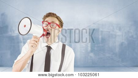 Geeky businessman shouting through megaphone against city scene in a room
