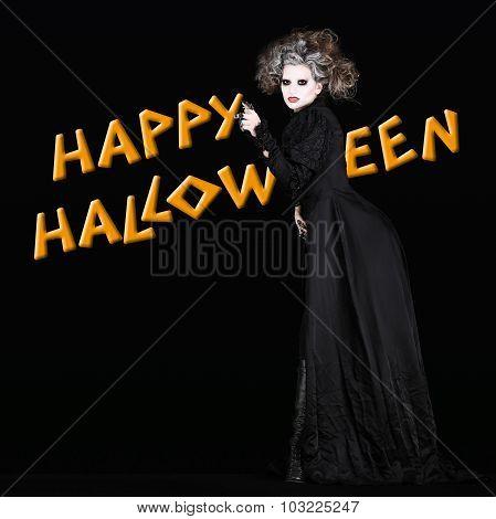 happy halloween vampire woman with black gothic costume