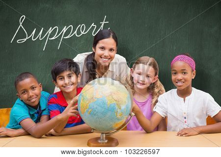 The word support and cute pupils and teacher looking at globe in library against green chalkboard