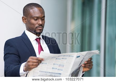 Portrait of a businessman reading a newspaper