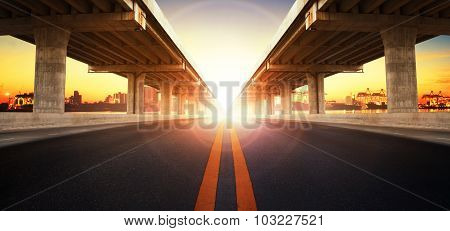 Sun Rising Behind Perspective On Bridge Ram Construction And Asphalt Raod Perspective To Ship Port B